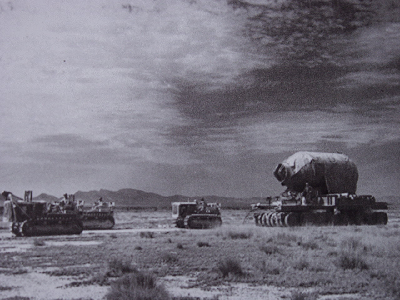"""In this historic photo, military personnel are seen moving """"Jumbo"""" to Trinity Site. (Photo courtesy National Park Service)"""